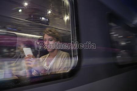 businesswoman using smart phone on passenger