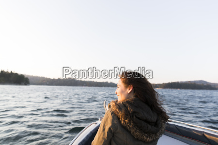 smiling woman boating on sunny tranquil