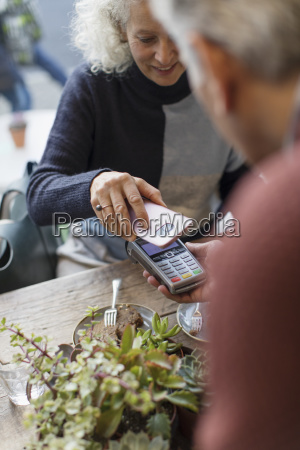 woman with smart phone using contactless