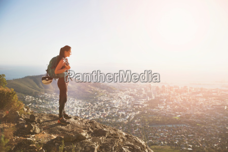 female rock climber on top of