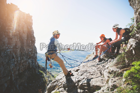 rock climbers with ropes on sunny