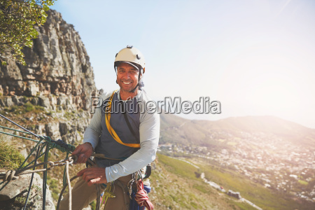 portrait smiling confident rock climber