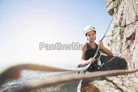 portrait confident female rock climber with