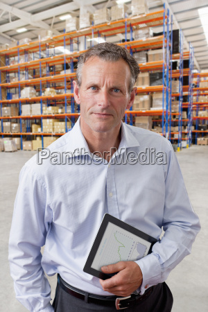 portrait of businessman with digital tablet