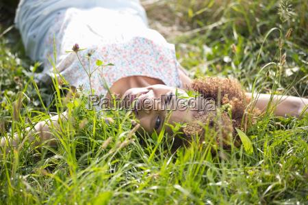 outdoor portrait of attractive woman lying