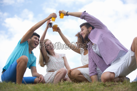 young couples making a toast with