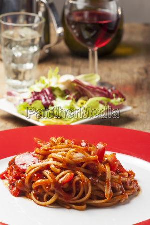 portion of spaghetti with tomato sauce
