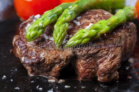 beef tenderloin and green asparagus in
