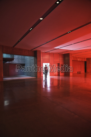 businessman walks through the door of