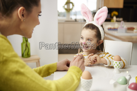 girl with bunny ears and mother