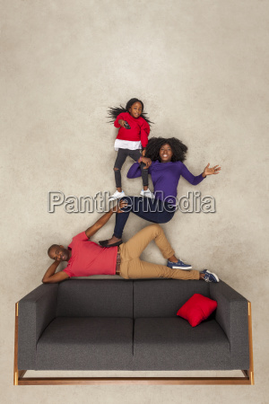 happy family at home on couch