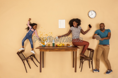 stressed out family having breakfast in