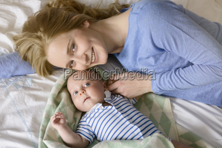 portrait of smiling mother with her