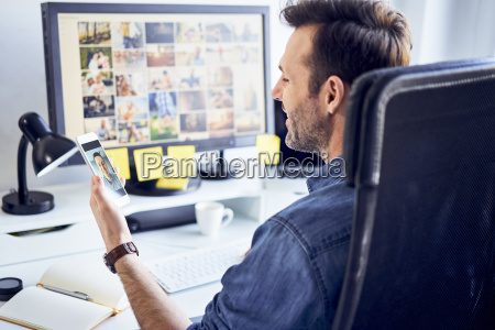photo editor at desk in office