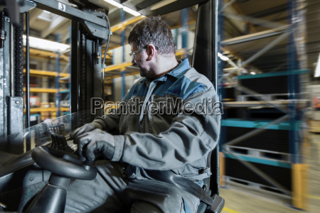 fork lift driver in motion in