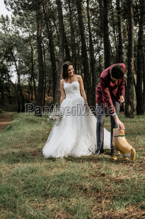 bride and groom in forest with