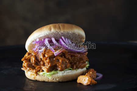 burger with jackfruit goulash in front