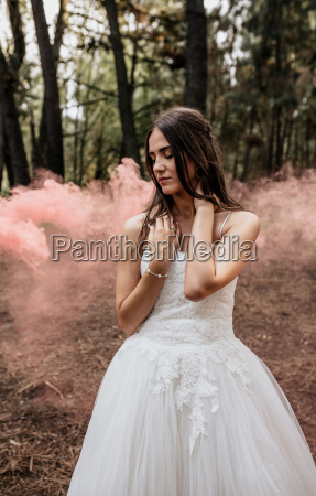 woman with closed eyes wearing wedding