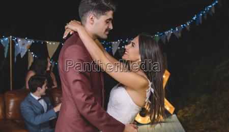 romantic wedding couple embracing on a