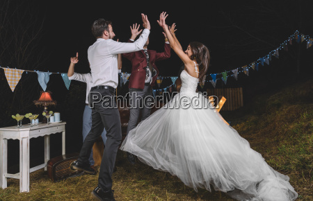 happy bride jumping and giving high