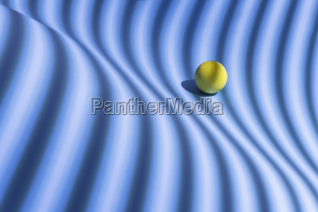 yellow sphere over a geometric blue