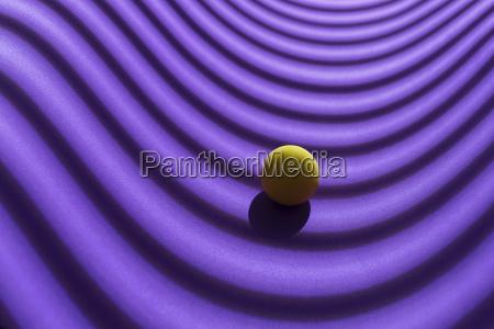 yellow sphere over a geometric purple