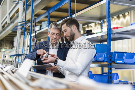 businessmen during meeting with tablet and