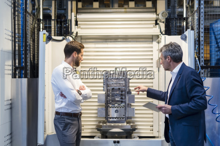 businessmen during meeting with tablet workpiece
