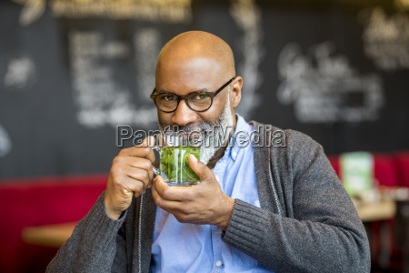 portrait of smiling man with glass
