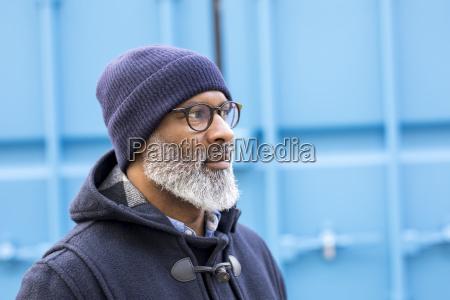portrait of man wearing blue woolly