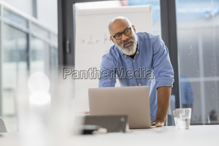 portrait of businessman in conference room