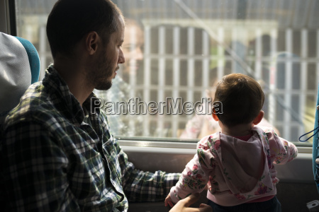 father and baby girl traveling by