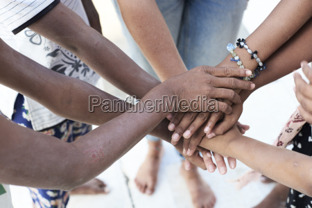 group of multiethnic people hands together