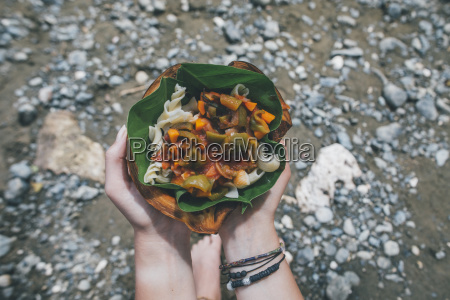 hands holing cuban dish in a