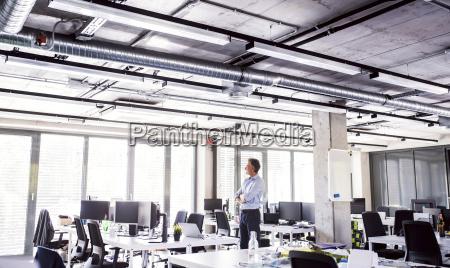 mature businessman standing in open plan