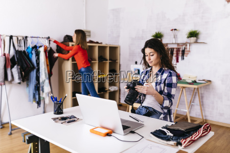 fashion designer with camera and laptop