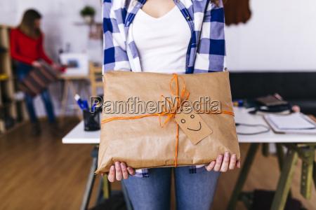 close up of fashion designer holding