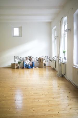 mature couple sitting on floor in