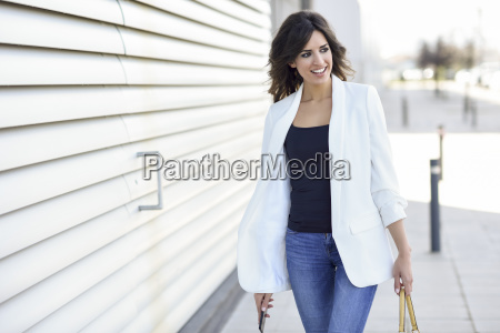 portrait of smiling businesswoman with cell