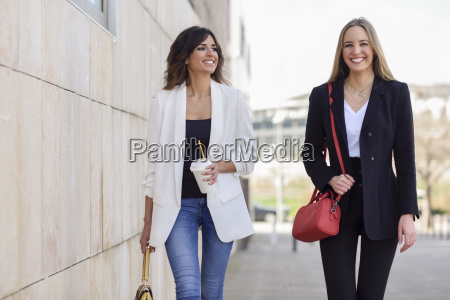 portrait of two happy businesswomen with