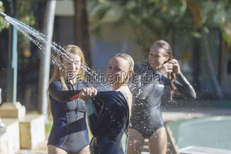 indonesia bali female surfers showering