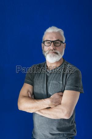 portrait of confident bearded mature man