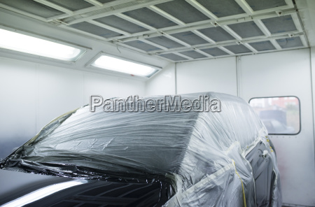 car inside a paint booth in