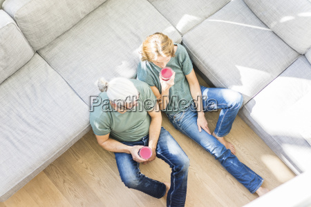 mature couple with healthy drinks in