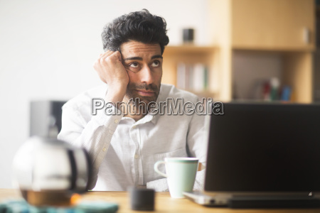 portrait of thinking businessman at desk
