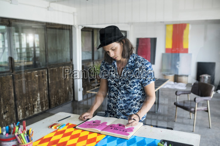 artist at work drawing in a