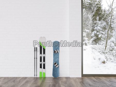 skis and snowboard at a wall