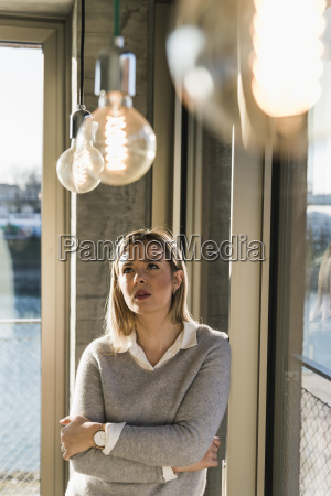young businesswoman in office looking at