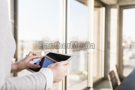 close up of businesswoman using tablet