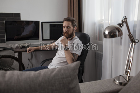 portrait of bearded man sitting in